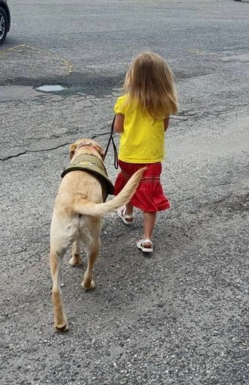 Child Heeling with Autism Service Dog