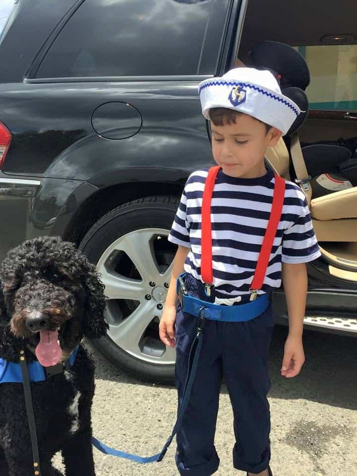 Autism Service Dog and child tethered together
